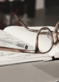 glasses sitting on a notebook